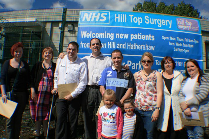 "<p> <img src=""teamphoto.jpg"" alt=""Smiling team photo"">Patient winning award </p>"